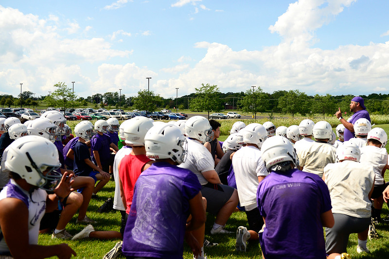 Kayla Wolf - for Shaw Media Hampshire High School Head Football Coach Michael Brasile addresses the team before their first official practice of the season Monday, Aug. 7, 2017, at Hampshire High School.