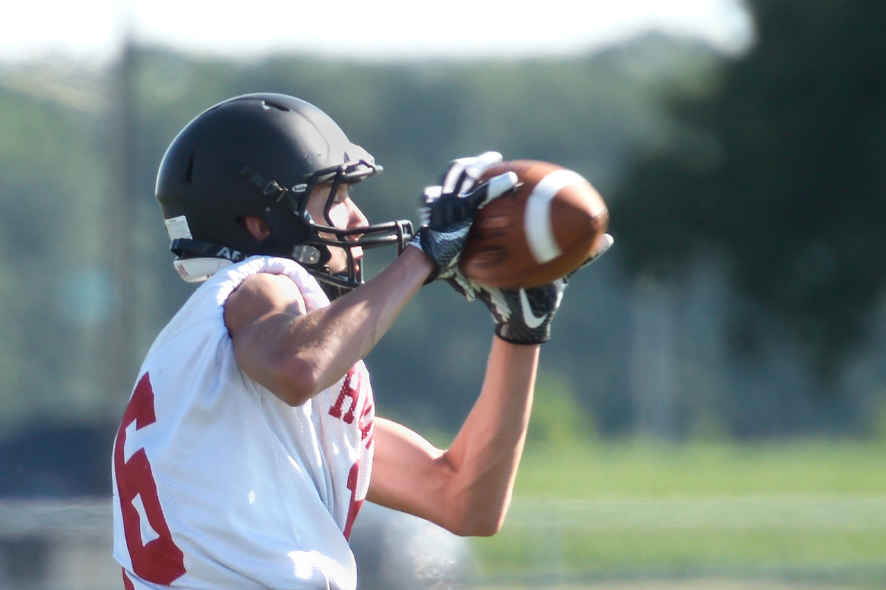 Kayla Wolf - for Shaw Media Senior receiver Brian O'Mara catches the ball during a seven on seven drill Tuesday, Aug. 8, 2017, at Huntley High School.