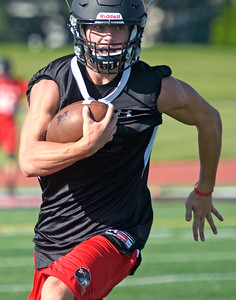 Kayla Wolf - for Shaw Media Senior quarterback Eric Mooney runs the ball during practice Tuesday, Aug. 8, 2017, at Huntley High School.