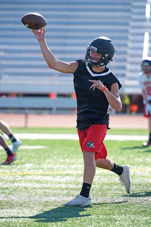 Kayla Wolf - for Shaw Media Senior quarterback Eric Mooney throws the ball during practice Tuesday, Aug. 8, 2017, at Huntley High School.