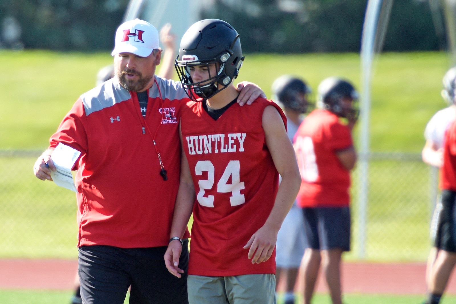 Kayla Wolf - for Shaw Media Huntley Head Coach Matt Zimolzak talks with senior strong safety Tyler Koss during a drillTuesday, Aug. 8, 2017, at Huntley High School.