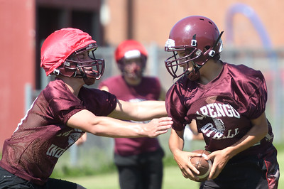 Kayla Wolf - for Shaw Media Marengo's Matt Meranda, left, tackles Jeff Nawrot, right, Tuesday, Aug. 8, 2017, during practice at Marengo High School.