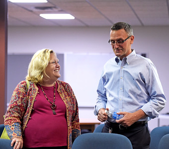 Kayla Wolf - for Shaw Media Regional Superintendent of Schools Leslie Schermerhorn congratulates Steve Olson on being appointed interim superintendent following a Community High School District 155 school board meeting Wednesday, Aug. 9 2017, at the Center for Education in Crystal Lake. The selection came after former District 155 superintendent Johnnie Thomas resigned Tuesday.