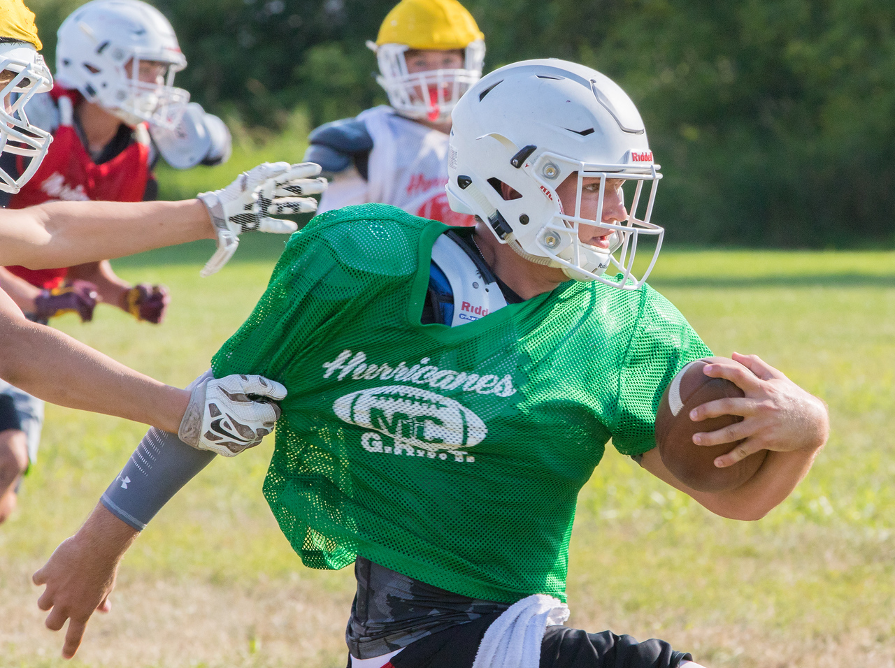Marion Central Catholic High School's quarterback Gavin Scott runs through the defense during practice Wednesday, August 9, 2017 at Marion Central High School in Woodstock. Ken Koontz – For Shaw Media