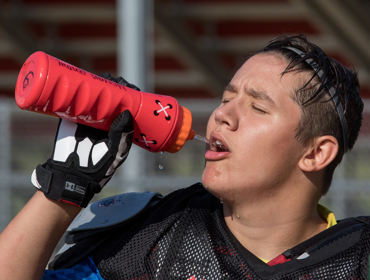 Marion Central Catholic High School's linebacker Patrick Brunken hits the water during practice Wednesday, August 9, 2017 at Marion Central High School in Woodstock. Ken Koontz – For Shaw Media