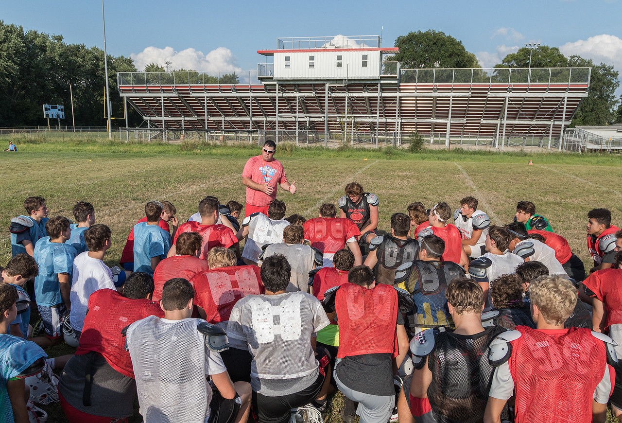 Marion Central Catholic High School head coach Mike Maloney talks with his team during practice Wednesday, August 9, 2017 at Marion Central High School in Woodstock. Ken Koontz – For Shaw Media