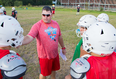 Marion Central Catholic High School head coach Mike Maloney instructs his team during practice Wednesday, August 9, 2017 at Marion Central High School in Woodstock. Ken Koontz – For Shaw Media