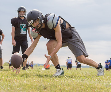 Woodstock North High School receiver Joe Grover works on fumble recovery drills during practice Thursday, August 10, 2017 in Woodstock.  Ken Koontz – For Shaw Media