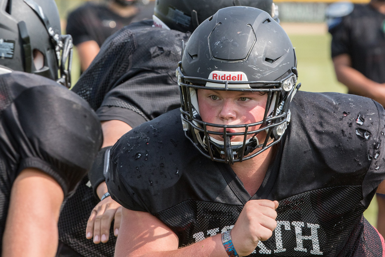 Woodstock North High School lineman Dylan Martinez drives through the offensive line during practice Thursday, August 10, 2017 in Woodstock.  Ken Koontz – For Shaw Media