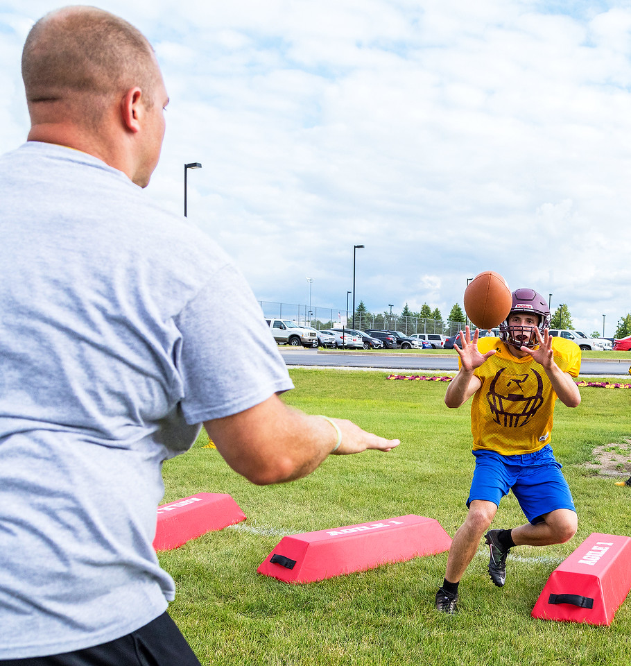 Richmond Burton High School Co-Head Coach Tad DePorter (left) runs a drill with Mike Kaufman (right) during football practice Friday, August 11, 2017 in Richmond. KKoontz- For Shaw Media