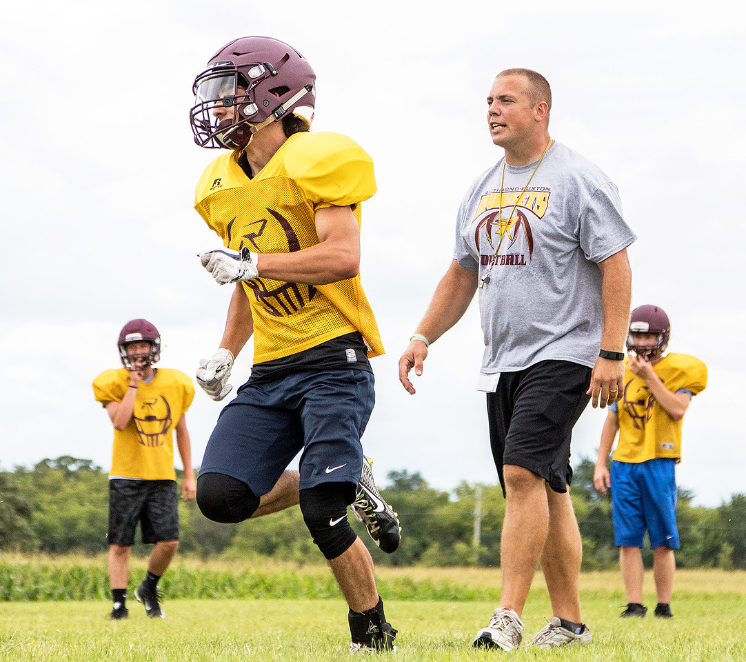 Richmond Burton High School Co-Head Coach Tad DePorter (right) motivates his team during football practice Friday, August 11, 2017 in Richmond. KKoontz- For Shaw Media