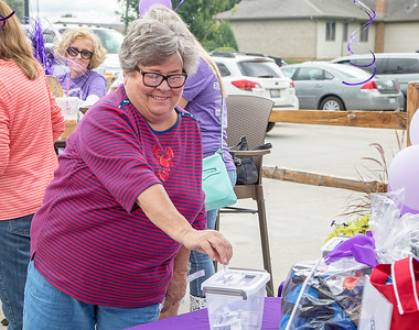 tries her luck at one of the raffles Saturday, August 12, 2017 during the Turning Point fundraiser at Niko's Red Mill in Woodstock. Turning Point is a domestic violence agency with a mission to confront violence against women and children in McHenry County, Illinois. KKoontz- For Shaw Media