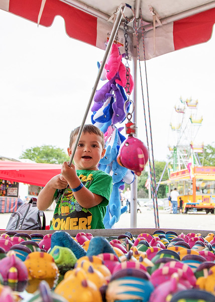 Jaxson Kolota (age 3) from McHenry brings in a whopper at the fishing game Sunday, August 13, 2017 during the annual Lakemoor Fest in Lakemoor. KKoontz – for Shaw Media