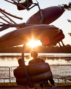 Thrill seekers enjoy the evening riding the paratrooper along Lily Lake in Lakemoor during the annual Lakemoor Fest Saturday, August 12, 2017.  KKoontz – for Shaw Media