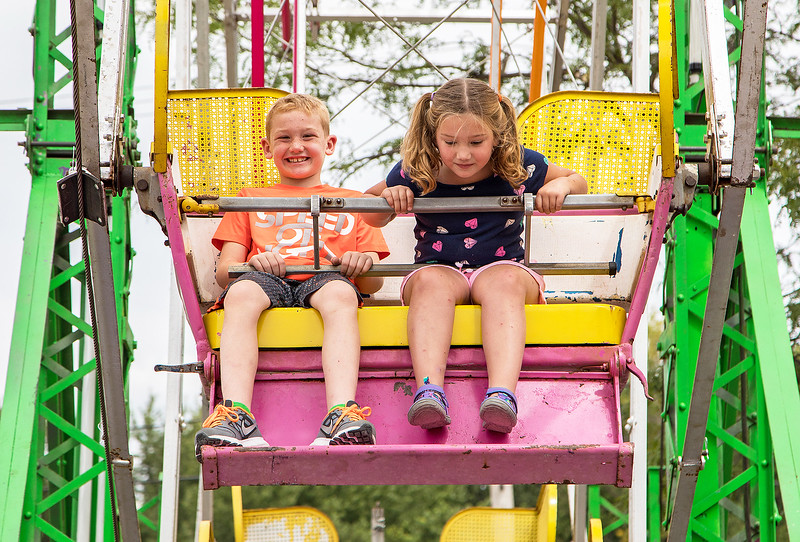 Travis and Laura Price from McHenry take a spin on the Ferris wheel during the annual Lakemoor Fest Sunday, August 13, 2017 in Lakemoor. KKoontz – for Shaw Media
