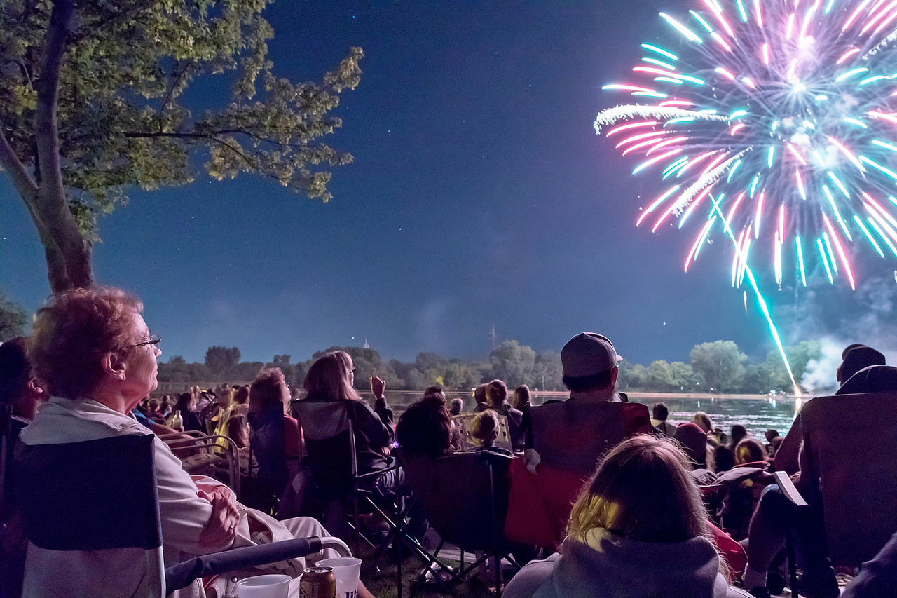 Lorraine Kehoe (left) from Ingleside enjoys a spectacular fireworks display along Liliy Lake during the annual Lakemoor Fest in Lakemoor Saturday, August 12, 2017.  KKoontz – for Shaw Media