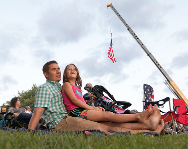 Jeff Fuller and his daughter Ari from Volo, anxiously await the fireworks in Lakemoor during the annual Lakemoor Fest Saturday, August 13, 2017.  KKoontz – for Shaw Media