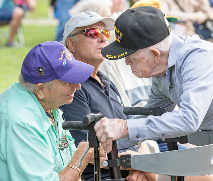 """World War II veterans Raul Zuniga (Right) and Chuck Budreck swap stories during McHenry's annual Spirit of '45 event celebrating the end of World War II and """"The Greatest Generation"""" at Veterans Memorial Park in McHenry Sunday, August 13, 2017.  KKoontz- for Shaw Media"""