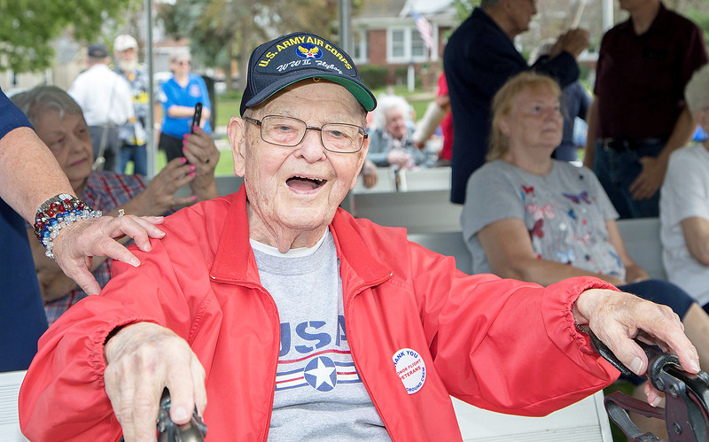"""World War II veteran Walter Herrmann enjoys the band during McHenry's annual Spirit of '45 event celebrating the end of World War II and """"The Greatest Generation"""" at Veterans Memorial Park in McHenry Sunday, August 13, 2017.  KKoontz- for Shaw Media"""