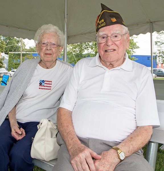 """World War II veteran Marion Messman along with his wife Grace and pose for a photo during McHenry's annual Spirit of '45 event celebrating the end of World War II and """"The Greatest Generation"""" at Veterans Memorial Park in McHenry Sunday, August 13, 2017.  KKoontz- for Shaw Media"""