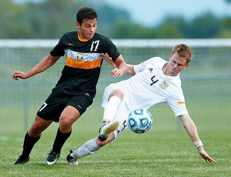 Daniel Buirge (4) from Jacobs keeps the ball from Amor Shareef (17) from Metea Valley during the first half of their game at Jacobs High School on Monday, August 21, 2017 in Algonquin, Illinois. The Mustangs defeated the Golden Eagles 3-2. John Konstantaras photo for the Northwest Herald