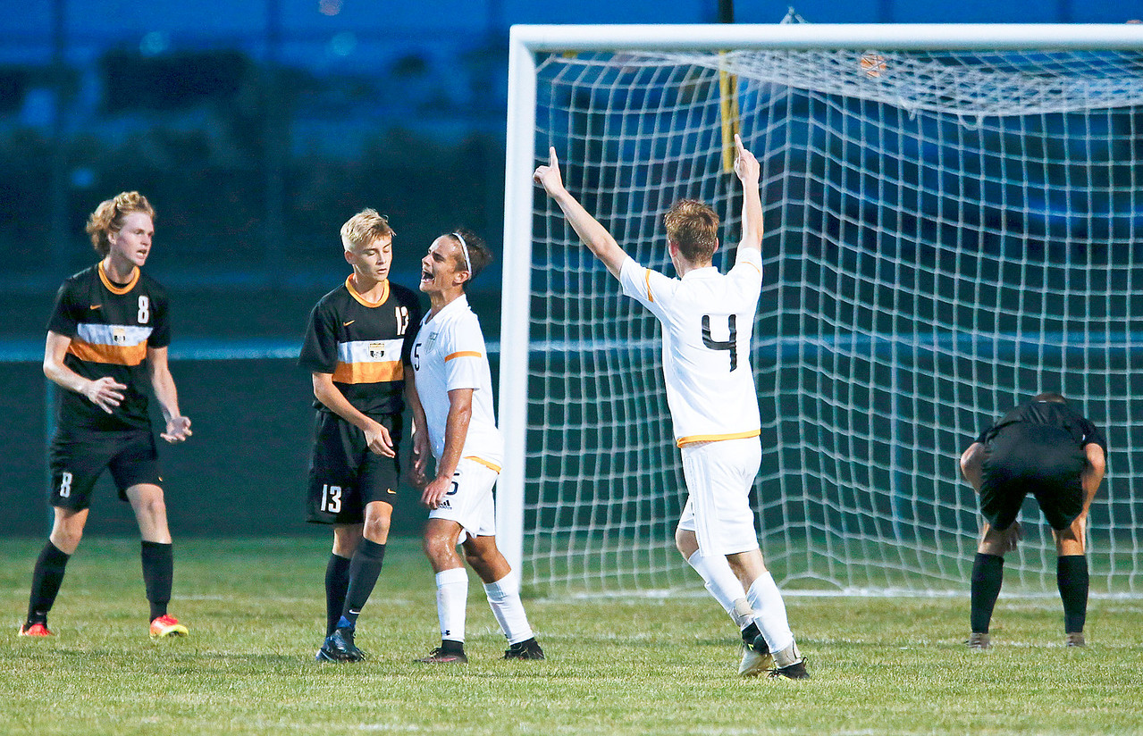 Colin Walsh (center) from Jacobs celebrates his second goal during the second half of their game against Metea Valley at Jacobs High School on Monday, August 21, 2017 in Algonquin, Illinois. The Mustangs defeated the Golden Eagles 3-2. John Konstantaras photo for the Northwest Herald
