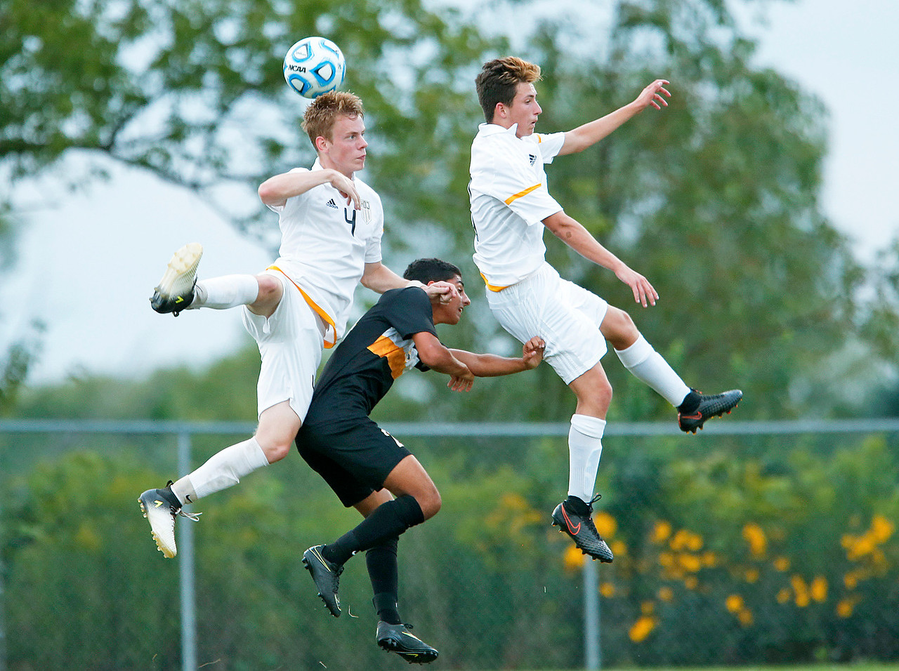 Daniel Buirge (4) from Jacobs heads the ball over Antar Abraham (24) from Metea Valley during the first half of their game at Jacobs High School on Monday, August 21, 2017 in Algonquin, Illinois. The Mustangs defeated the Golden Eagles 3-2. John Konstantaras photo for the Northwest Herald
