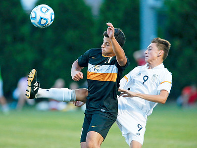 Alex Nicastro (9) from Jacobs clears the ball around Amor Shareef (17) from Metea Valley during the second half of their game at Jacobs High School on Monday, August 21, 2017 in Algonquin, Illinois. The Mustangs defeated the Golden Eagles 3-2. John Konstantaras photo for the Northwest Herald