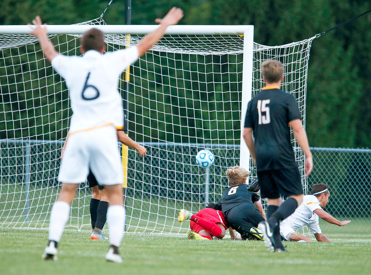 Noah Melick (6) from Jacobs celebrates as Colin Walsh (5) from Jacobs scores a goal during the first half of their game against Metea Valley at Jacobs High School on Monday, August 21, 2017 in Algonquin, Illinois. The Mustangs defeated the Golden Eagles 3-2. John Konstantaras photo for the Northwest Herald