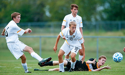 Liam Armstrong (18) from Jacobs watches as James Kooi (16) clears the ball past James Lynch (behind) from Metea Valley during the first half of their game at Jacobs High School on Monday, August 21, 2017 in Algonquin, Illinois. The Mustangs defeated the Golden Eagles 3-2. John Konstantaras photo for the Northwest Herald