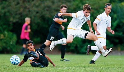 Gabriel Swarthout (2) from Jacobs chase a ball during the first half of their game against Metea Valley at Jacobs High School on Monday, August 21, 2017 in Algonquin, Illinois. The Mustangs defeated the Golden Eagles 3-2. John Konstantaras photo for the Northwest Herald