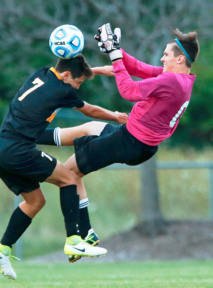 Goalie Preston Krahl (0) from Jacobs is hit by Evan Lang (7) from Metea Valley during the first half of their game at Jacobs High School on Monday, August 21, 2017 in Algonquin, Illinois. The Mustangs defeated the Golden Eagles 3-2. John Konstantaras photo for the Northwest Herald