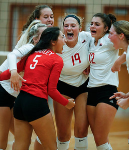 Huntley celebrates a point during their first game against Crystal Lake Central at Huntley High School on Tuesday, August 22, 2017 in Huntley. The Red Raiders defeated the Tigers in 3 games; 28-26, 18-25, 25-12John Konstantaras photo for the Northwest Herald