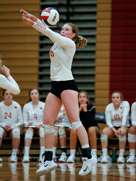 Aleah Amelio (16) from Huntley bombs a ball during their third game against Crystal Lake Central at Huntley High School on Tuesday, August 22, 2017 in Huntley. The Red Raiders defeated the Tigers in 3 games; 28-26, 18-25, 25-12John Konstantaras photo for the Northwest Herald