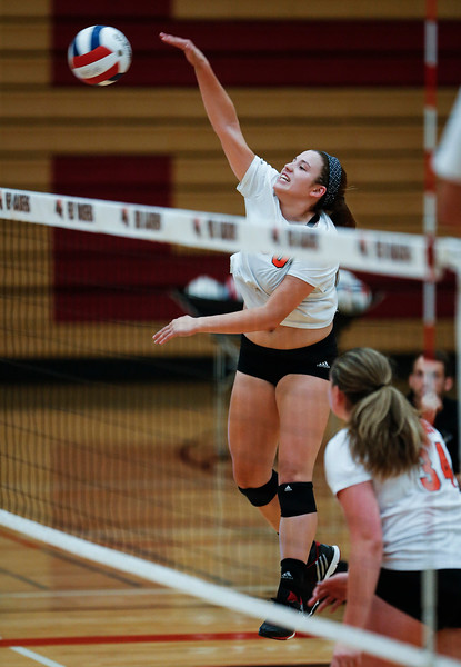 Camryn Hausler (50) from Crystal Lake Central scores the game point against Huntley during their second game at Huntley High School on Tuesday, August 22, 2017 in Huntley. The Red Raiders defeated the Tigers in 3 games; 28-26, 18-25, 25-12John Konstantaras photo for the Northwest Herald