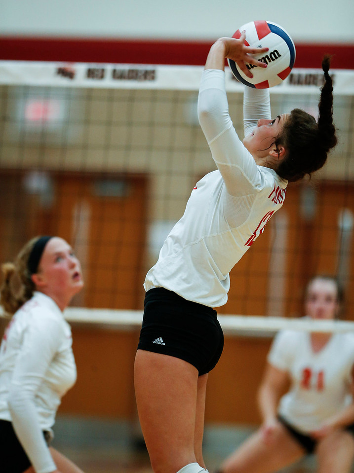Taylor Jakubowski (12) from Huntley sets the ball during their first game against Crystal Lake Central at Huntley High School on Tuesday, August 22, 2017 in Huntley. The Red Raiders defeated the Tigers in 3 games; 28-26, 18-25, 25-12John Konstantaras photo for the Northwest Herald
