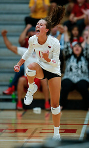 Emma Konie (17) from Huntley celebrates a point during their first game against Crystal Lake Central at Huntley High School on Tuesday, August 22, 2017 in Huntley. The Red Raiders defeated the Tigers in 3 games; 28-26, 18-25, 25-12John Konstantaras photo for the Northwest Herald