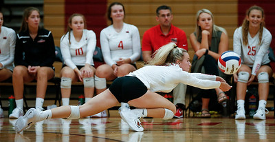 Josie Schmitendorf (11) from Huntley reaches for a ball during their third game against Crystal Lake Central at Huntley High School on Tuesday, August 22, 2017 in Huntley. The Red Raiders defeated the Tigers in 3 games; 28-26, 18-25, 25-12John Konstantaras photo for the Northwest Herald