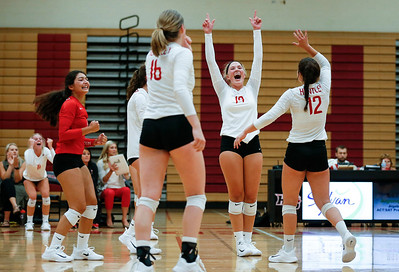 Loren Alberts (center) from Huntley celebrates game point with her teammates during their third game against Crystal Lake Central at Huntley High School on Tuesday, August 22, 2017 in Huntley. The Red Raiders defeated the Tigers in 3 games; 28-26, 18-25, 25-12John Konstantaras photo for the Northwest Herald