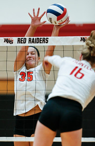 Madelyn Blake (35) from Crystal Lake Central blocks a ball hit by Aleah Amelio (16) from Huntley during their first game at Huntley High School on Tuesday, August 22, 2017 in Huntley. The Red Raiders defeated the Tigers in 3 games; 28-26, 18-25, 25-12John Konstantaras photo for the Northwest Herald