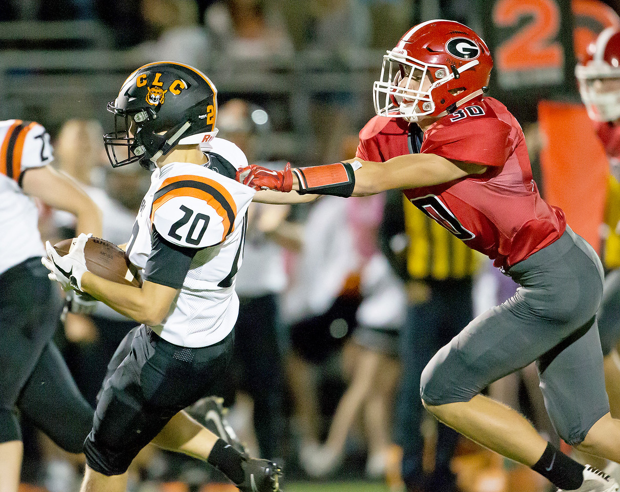 Ken Koontz - for Shaw Media Grant's Luke Bedrosian (30) grabs Crystal Lake Central's Cade Gau (20)  won 37-21 over Grant in a non-conference game Friday, Aug. 25, 2017.