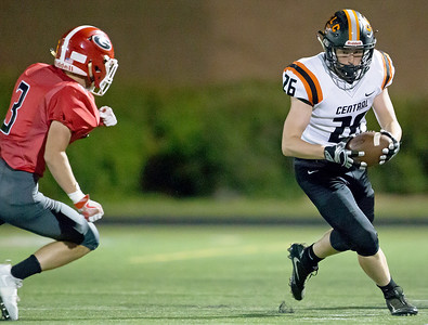 Ken Koontz - for Shaw Media Grant's Barrett Innes (3) chases Crystal Lake Central's Drew Jenkins. Central won 37-21 over Grant in a non-conference game Friday, Aug. 25, 2017.