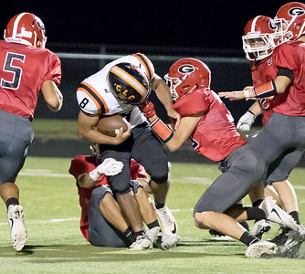 Ken Koontz - for Shaw Media Crystal Lake Central's Braden Bisram is bought down by a host of Grant players. Crystal Lake Central won, 37-21 over Grant in a non-conference game Friday, Aug. 25, 2017.