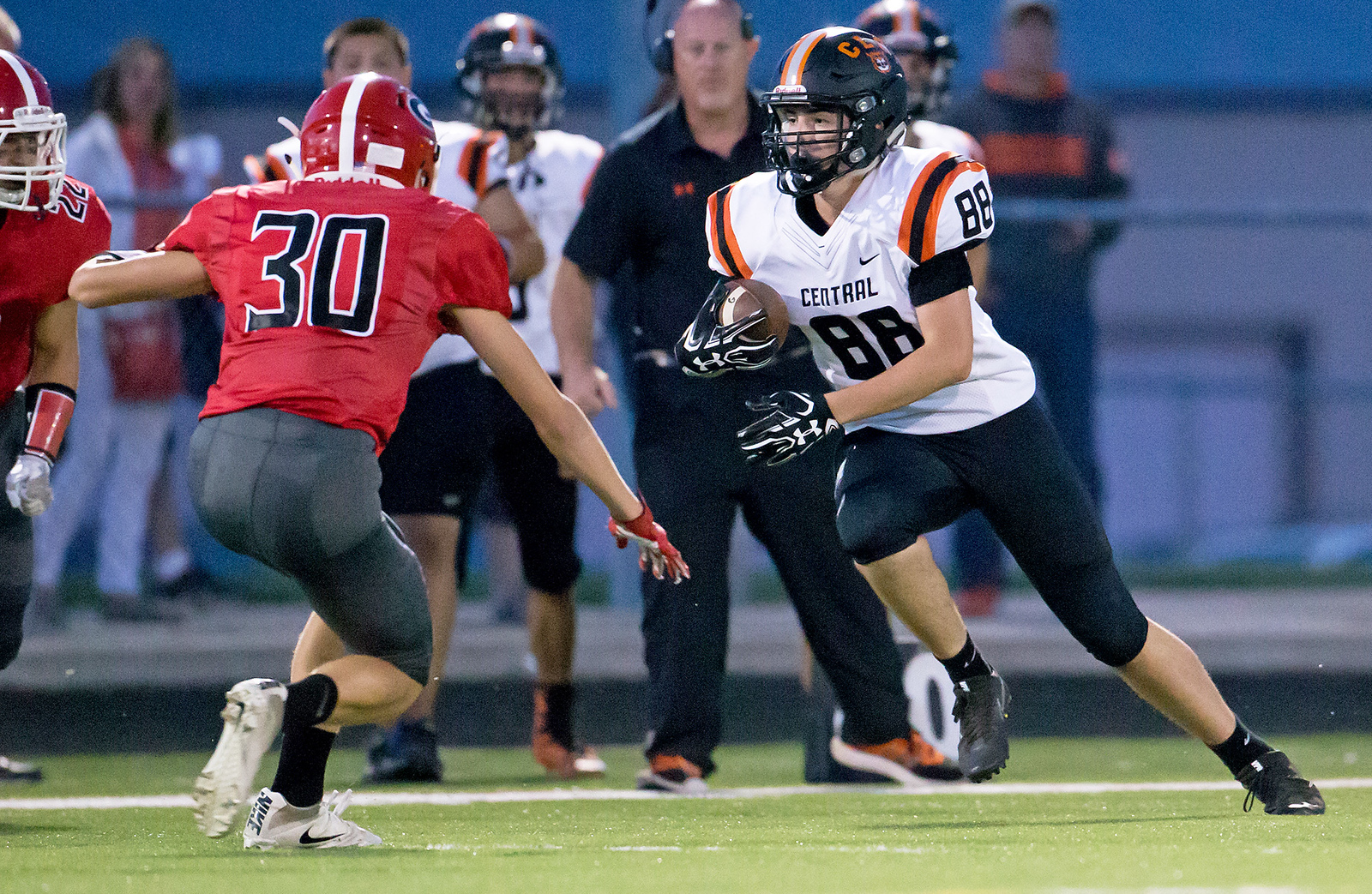 Ken Koontz - for Shaw Media Grant's Luke Bedrosian (30) looks to stop Crystal Lake Central's Anthony Beck. Crystal Lake Central won 37-21 over Grant in a non-conference game Friday, Aug. 25, 2017.