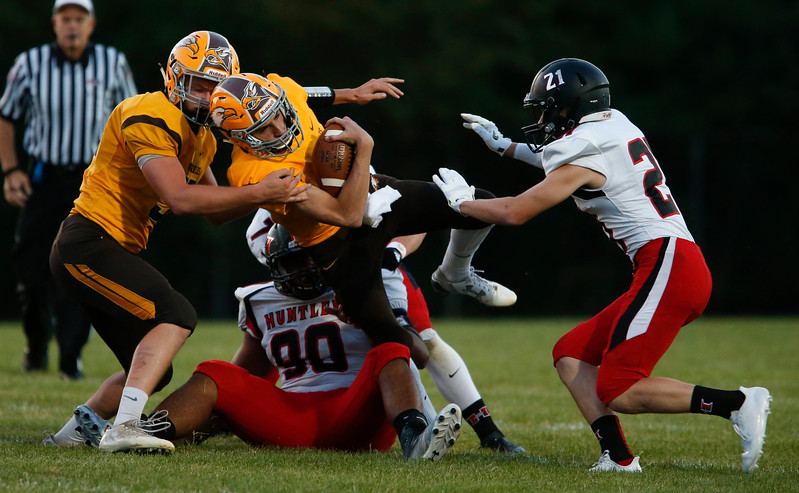 Anthony Wilson (2) from Jacobs is tackled on a keeper during the first quarter of their game at Jacobs High School on Friday, August 25, 2017 in Algonquin, Illinois. John Konstantaras photo for the Shaw Media