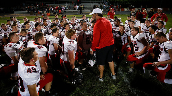 Huntley head coach Matt Zimolzak talks to his team after beating Jacobs 30-27 in the final seconds of their game at Jacobs High School on Friday, August 25, 2017 in Algonquin, Illinois. The Red Raiders defeated the Golden Eagles 30-27. John Konstantaras photo for the Shaw Media