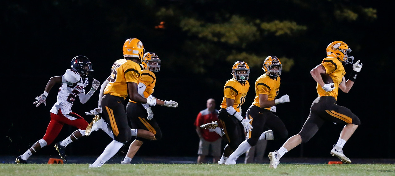 Trevor Fitzsimmons (4) from Jacobs runs for an 85-yard punt return touchdown during the first quarter of their game against Huntley at Jacobs High School on Friday, August 25, 2017 in Algonquin, Illinois. John Konstantaras photo for the Shaw Media