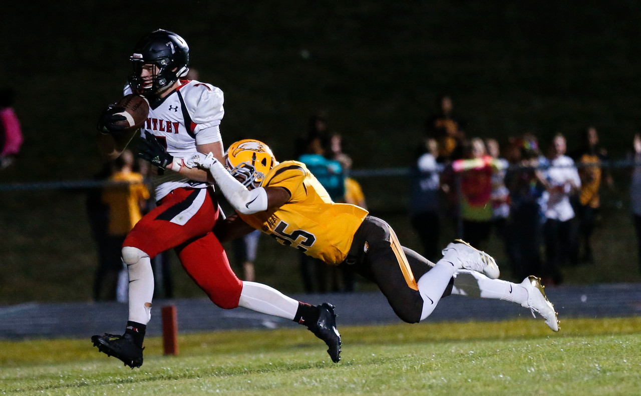Joey Cauldren (7) from Huntley is tackled by Jukauri Bland (25) from Jacobs as he score the 2-point conversion during the fourth quarter of their game at Jacobs High School on Friday, August 25, 2017 in Algonquin, Illinois. The Red Raiders defeated the Golden Eagles 30-27. John Konstantaras photo for the Shaw Media