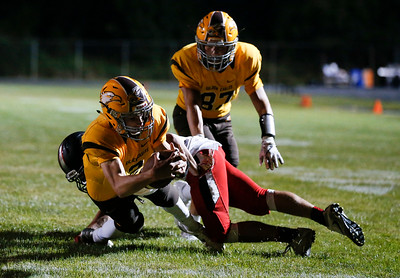 Anthony Wilson (2) from Jacobs is tackled by Peter Murray (42) from Huntley as he scores a touchdown during the fourth quarter of their game at Jacobs High School on Friday, August 25, 2017 in Algonquin, Illinois. The Red Raiders defeated the Golden Eagles 30-27. John Konstantaras photo for the Shaw Media