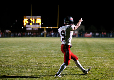 Eric Mooney (5) from Huntley celebrates after scoring the game winning touchdown with 7.7 seconds in the fourth quarter of their game at Jacobs High School on Friday, August 25, 2017 in Algonquin, Illinois. The Red Raiders defeated the Golden Eagles 30-27. John Konstantaras photo for the Shaw Media